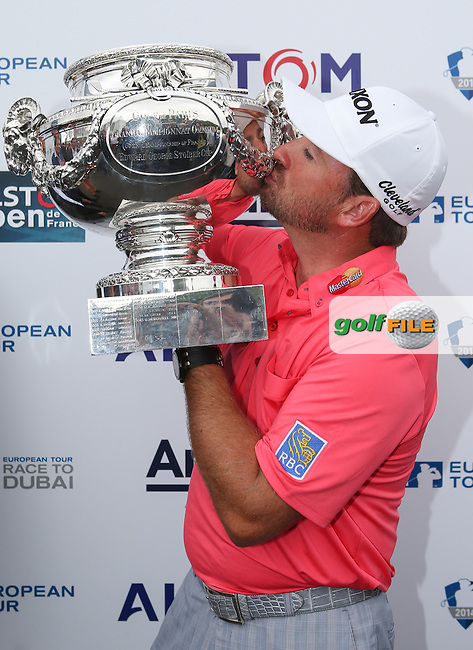 GRAEME MCDOWELL (NIR) kisses the Trophy and wins the Final Round of the Alstom Open de France for the consecutive year, from Le Golf National, Guyancourt, Versailles, France. Picture:  David Lloyd / www.golffile.ie