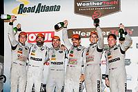#77 Mazda Team Joest Mazda DPi, P: Oliver Jarvis, Tristan Nunez, Lucas Di Grassi, #55 Mazda Team Joest Mazda DPi, P: Jonathan Bomarito, Marino Franchitti, Spencer Pigot, podium