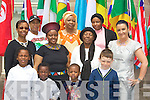 DRESSED: dressed up in their national colours to mark Africa Week, in St John's Pastoral Centre on Sunday. Front l-r: Thokozani Siziba, Dumise Siziba, Togor Silong and Cody Barry. Back l-r: Olga Ncube, Nogugii Mafy, Dora Naube, Joanne Barry, Meris Moyo, Alhere Silong and Charlotte Mafhtia..