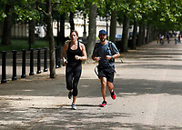 16th May 2020, London, England;  Runners running towards Buckingham Palace on the mall while not wearing gloves or a mask