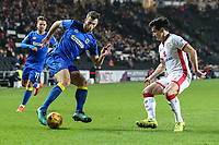 Jonathan Meades of AFC Wimbledon looks for a way past January transfer target George Williams of MK Dons during the Sky Bet League 1 match between MK Dons and AFC Wimbledon at stadium:mk, Milton Keynes, England on 13 January 2018. Photo by David Horn.