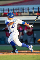 Josh Banuelos (27) of the Burlington Royals follows through on his swing against the Danville Braves at Burlington Athletic Park on July 5, 2014 in Burlington, North Carolina.  The Royals defeated the Braves 5-4.  (Brian Westerholt/Four Seam Images)