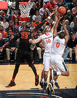Miami center Tonye Jekiri (23)reaches for the rebound with Virginia center Mike Tobey (10) and Virginia guard Devon Hall (0) during the game Tuesday, Jan. 12, 2016 in Charlottesville, Va. Virginia defeated Miami 66-58. Photo/Andrew Shurtleff