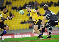 James Marshall pops a pass to Ma'a Nonu during the Super Rugby match between the Hurricanes and Sharks at Westpac Stadium, Wellington, New Zealand on Saturday, 9 May 2015. Photo: Dave Lintott / lintottphoto.co.nz