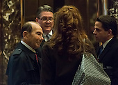 Former CEO of AIG Maurice Greenberg (L) is seen waiting for an elevator in the lobby of Trump Tower where we converses with Trump's financial advisor Anthony Scaramucci (R) in New York, NY, USA on December 12, 2016. <br /> Credit: Albin Lohr-Jones / Pool via CNP