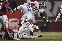 NWA Media/ J.T. Wampler - Alabama's Derrick Henry leaps for extra yards in the third quarter Saturday Oct. 11, 2014 against Arkansas in Fayetteville.