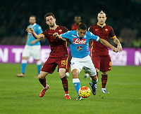 Napoli's Miguel Allan  fight for the ball with  AS Roma's Miralem Pjanic  during the  italian serie a soccer match,between SSC Napoli and AS Roma       at  the San  Paolo   stadium in Naples  Italy ,December 13, 2015