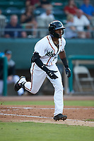 Julio Pablo Martinez (23) of the Down East Wood Ducks hustles down the first base line against the Winston-Salem Dash at Grainger Stadium Field on May 17, 2019 in Kinston, North Carolina. The Dash defeated the Wood Ducks 8-2. (Brian Westerholt/Four Seam Images)