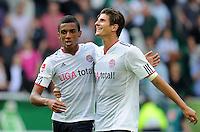 FUSSBALL   1. BUNDESLIGA   SAISON 2011/2012    2. SPIELTAG VfL Wolfsburg - FC Bayern Muenchen      13.08.2011 Luiz GUSTAVO (li) und Mario GOMEZ (re, beide Bayern) jubeln nach dem Abpfiff.