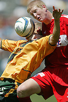 12 June 2004: Fire Defender Jim Curtin battles for the ball in the air against Galaxy Forward Alejandro Moreno at Home Depot Center in Los Angeles, California.    Mandatory Credit: Michael Pimentel / ISI
