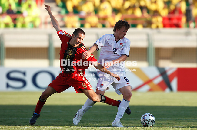 SUEZ, EGYPT - SEPTEMBER 26:  Mario Vrancic of Germany (l) battles with Jared Jeffrey of the United States (r) during a FIFA U-20 World Cup soccer match September 26, 2009 in Suez, Egypt.  (Photograph by Jonathan P. Larsen)