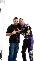 Feb 8, 2017; Pomona, CA, USA; NHRA funny car driver Jack Beckman and photographer Guy Rhodes pose for a portrait during media day at Auto Club Raceway at Pomona. Mandatory Credit: Mark J. Rebilas-USA TODAY Sports