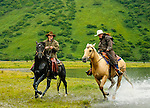 Horseback riding on the Pasagshak Ranch, Kodiak Island, Alaska. An island on the south coast of the U.S. state of Alaska. The largest island in the Kodiak Archipelago, and second largest in the U.S.. (Chris Flickinger and Rochelle Wood)