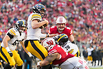 Wisconsin Badgers defensive lineman Olive Sagapolu (99) sacks Iowa Hawkeyes quarterback Nate Stanley (4) during an NCAA College Big Ten Conference football game Saturday, November 11, 2017, in Madison, Wis. The Badgers won 38-14. (Photo by David Stluka)