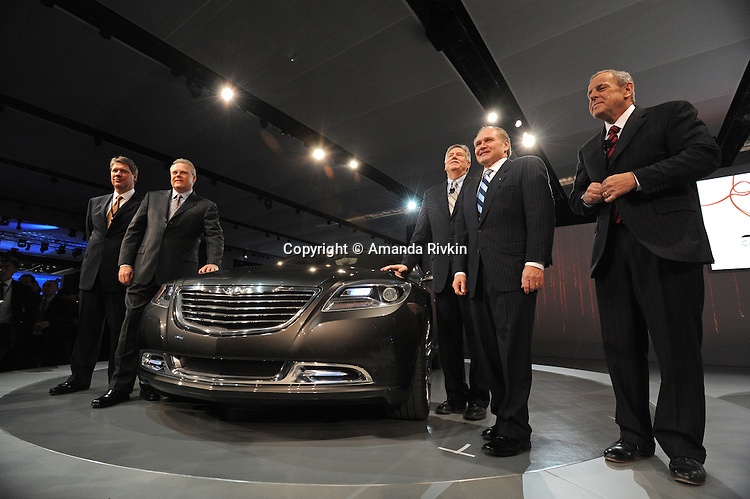 The Chrysler team, including CEO Robert Nardelli (second from right) and Vice-Chairman and President Jim Press (far right) is seen after the Chrysler presentation at the Detroit Auto Show in Detroit, Michigan on January 11, 2009.
