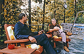 President Anwar al-Sadat of Egypt, left, and United States President Jimmy Carter have a discussion on the porch of Aspen Lodge at Camp David, the US presidential retreat near Thurmont, Maryland as part of the Egypt-Israel Summit in September, 1978..Credit: White House via CNP