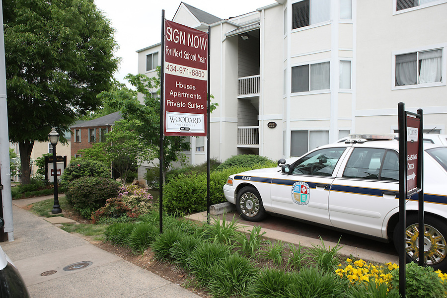 Police cars were parked outside the apartment building where UVa women's lacrosse player Yeardley Love, 22, a fourth-year student from Cockeysville, Md., was allegedly murdered by Virginia men's lacrosse player George Huguely, 22, a fourth-year student from Chevy Chase, Md., Monday May 3, 2010 in Charlottesville, Va. The alleged incident happened early Monday morning in the Yeardley's apartment located near the University of Virginia. Photo/Andrew Shurtleff.