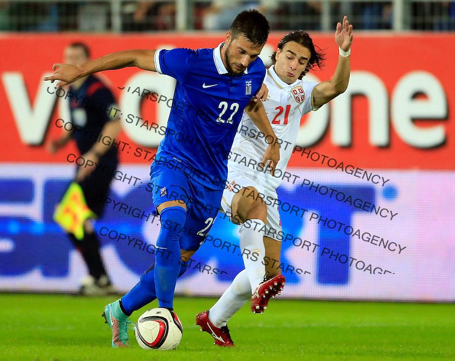 Fudbal<br /> Prijateljski mec-Friendly match<br /> Srbija v Grcka<br /> Andreas Samaris (L) and Lazar Markovic<br /> Chania, 17.11.2014.<br /> foto: Srdjan Stevanovic/Starsportphoto &copy;