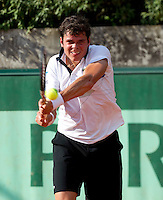 Milos Raonic..Tennis - Grand Slam - French Open- Roland Garros - Paris - Mon May 28th 2012...© AMN Images, 30, Cleveland Street, London, W1T 4JD.Tel - +44 20 7907 6387.mfrey@advantagemedianet.com.www.amnimages.photoshelter.com.www.advantagemedianet.com.www.tennishead.net