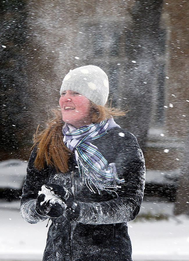 Jan. 31, 2013; A Notre Dame student engages in a snowball fight in South Quad during a snow shower.  Photo by Barbara Johnston/University of Notre Dame