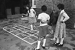Junior school children playing playground games. South London. 1970s England. UK..