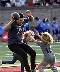 (Boston, Ma 06/03/16)  Tom  Brady is chased down by two pint sized defenders, Joey Shiver, 6, center, son of Anthony Shiver and family friend Lucas Bacardi Shriftman, during Best Buddies, Friday, June 3, 2016, at Harvard Stadium. Herald Photo by Jim Michaud