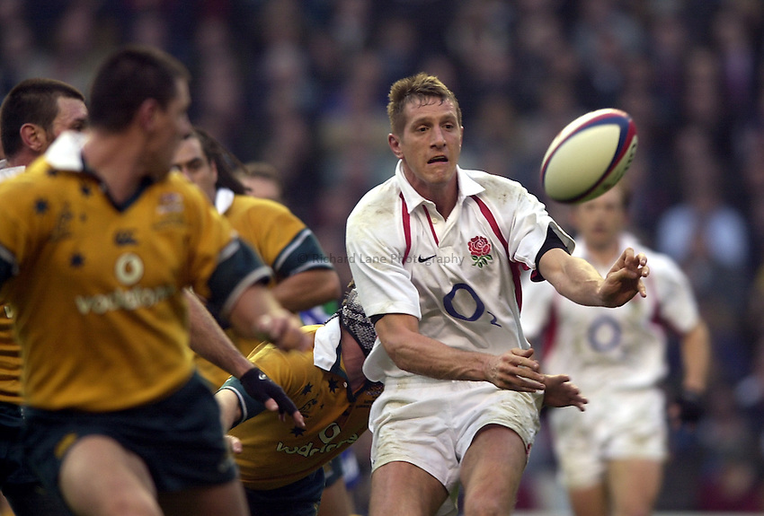 Photo. Richard Lane.England v Australia at Twickenham. 16-11-2002.Investec Challenge Cook Cup..Wll Greenwood gets the ball away.