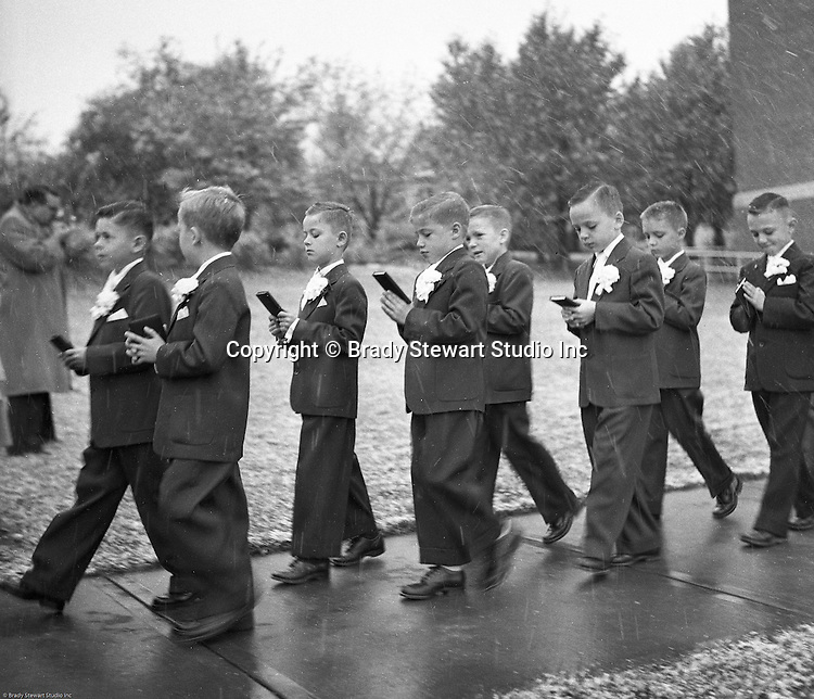 Bethel Park PA:  View of young catholic boys walking to church to receive their first holy communion at Saint Valentine's Church in Bethel Park PA - 1954.  Cathy Stewart was part of the class that received their first holy communion in 1954.  St Valentine's school opened in 1953 and is still in operation today.  Brady and Cathy Stewart attended the school from 1st thru 8th grades.  Michael Stewart attended from 1st thru 3rd grades.  He left and went to Hillcrest Elementary school after a disagreement with one of the nuns over a tuna fish sandwich!
