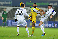 Stefan Payne of Bristol Rovers vies for possession with Cian Harries of Swansea City U21 during the Checkatrade Trophy match between Swansea City U21 and Bristol Rovers at the Liberty Stadium in Swansea, Wales, UK. Wednesday 05 December 2018