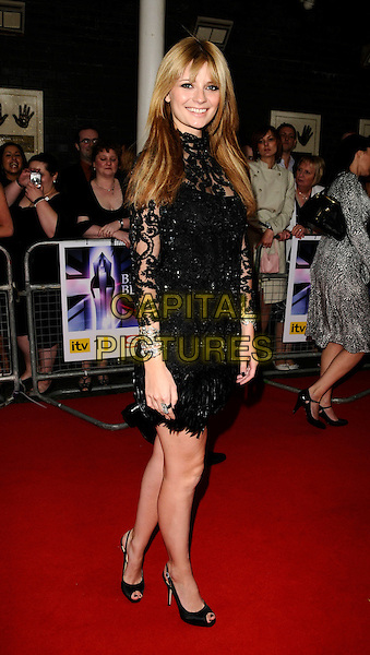 MISCHA BARTON.The Britain's Best 2008 Ceremony, The London Studios, South Bank, London, England..May 18th, 2008.full length black dress lace sheer  pattern feathers silver bracelets.CAP/CAN.©Can Nguyen/Capital Pictures.