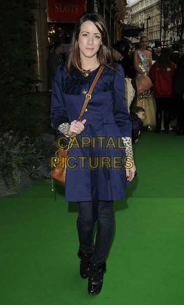 "NICOLA TAPPENDEN (Nicola T).""Yogi Bear"" UK film premiere gala screening, Vue cinema, Leicester Square London, England, UK, .February 6th 2011..arrivals full length blue trench coat jeans ankle boots black crown cross body bag  .CAP/CAN.©Can Nguyen/Capital Pictures."