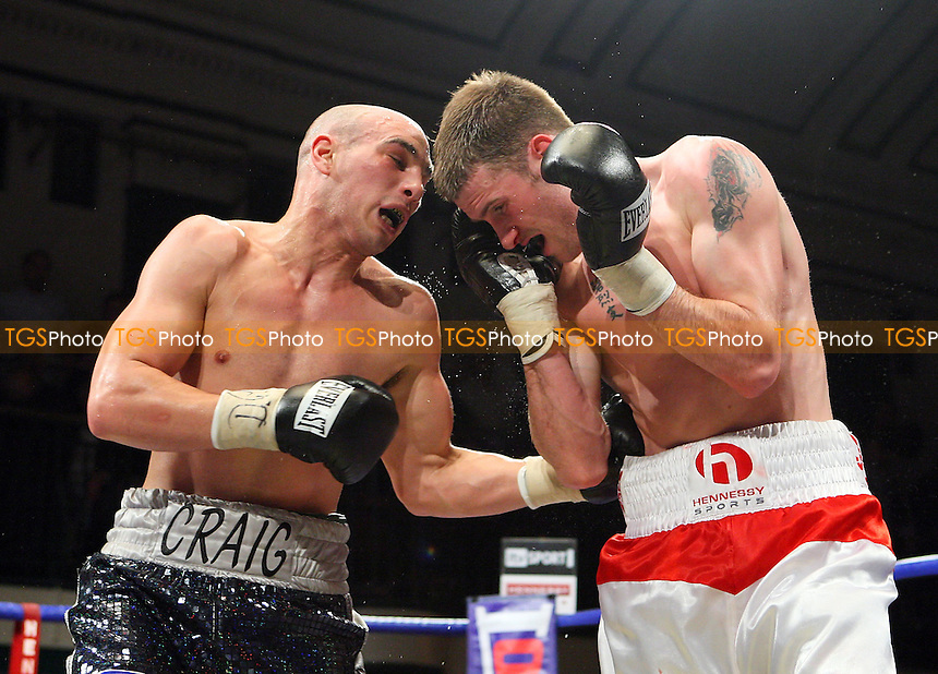 John O'Donnell (Shepherd's Bush, red/white shorts) defeats Craig Watson (Manchester) in a Welterweight boxing contest for the Commonwealth Title at York Hall, Bethnal Green, London, promoted by Hennessy Sports -  11/04/09 - MANDATORY CREDIT: Gavin Ellis/TGSPHOTO - Self billing applies where appropriate - Tel: 0845 094 6026