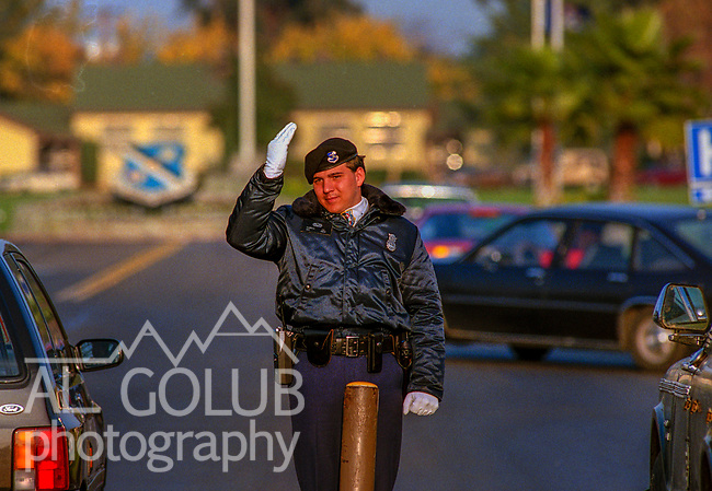Air Police guard Main Gate.<br /> <br /> Castle Air Force Base-October 28, 1988.  I photographed  basic scene setter images to go with base closure stories.  Photo by Al Golub<br /> <br /> Castle is named for Brigadier General Frederick W. Castle, who died on Dec. 24, 1944 flying his 30th bombing mission. He died leading an armada of 2000 B-17s on a strike against German airfields. On the way to the target, an engine failure over Liege, Belgium caused his bomber to fall behind, where it was attacked by Germans and caught fire. He ordered his men to bail out but stayed alone at the controls of the flaming Flying Fortress until it crashed. The entire crew, except Gen. Castle and one airman killed before the bailout order, survived. Gen. Castle received a Medal of Honor posthumously for his bravery.<br /> <br /> Castle became home to the 93rd Bombardment Wing in 1947. Aircraft stationed at Castle included B-29, B-17 and C-54 aircraft, with B-50 bombers arriving in 1949. In 1954, B-47 bombers arrived.  On June 29, 1955, Castle received the Air Force's first B-52. These heavy bombers can hold the equivalent of three railroad cars' worth of fuel. The first Air Force KC-135 jet tanker arrived May 18, 1957<br /> <br /> Castle was selected for closure under the Defense Base Closure and Realignment Act of 1990 during Round II Base Closure Commission deliberations (BRAC 91). The last of the B-52s left the base in 1994, followed by the departure of the last of the KC-135s in early 1995. The base closed September 30, 1995.