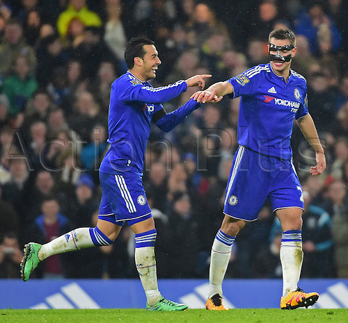 13.02.2016. Stamford Bridge, London, England. Barclays Premier League. Chelsea versus Newcastle United. Pedro celebrates his 2nd goal in the 59th minute with Cesar Azpilicueta