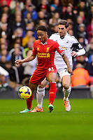Sunday, 23 February 2014<br /> Pictured: Liverpool's Raheem Sterling competes for the ball with Swansea City's Angel Rangel<br /> Re: Barclay's Premier League, Liverpool FC v Swansea City FC v at Anfield Stadium, Liverpool Merseyside, UK.