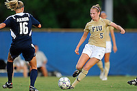 27 August 2011:  FIU's Johanna Volz (5) passes the ball in the first half as the FIU Golden Panthers defeated the University of Arkon Zips, 1-0, at University Park Stadium in Miami, Florida.