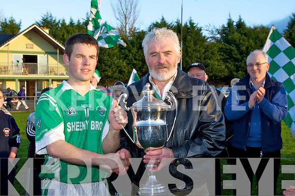 Mid Kerry chairman James Doyle presents the cup to Milltown Captain Shane Murphy