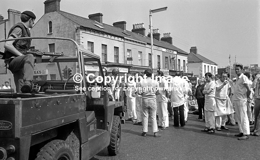 Angry bakery workers block the Springfield Road, Belfast, N Ireland, after the murder of company director, Charles Oliver Eaton, Protestant, who was shot by the Provisional IRA in the car park of the Peter Pan Bakery, on 30th June 1976. He died less than 30 minutes after the attack. A native of Londonderry he transferred to Belfast when his family's business amalgamated with the Bernard Hughes Bakery in Belfast to trade under the Peter Pan name. Mr Eaton was a member of the N Ireland Police Authority and a colonel in the Territorial Army. 197606300311COE3..Copyright Image from Victor Patterson, 54 Dorchester Park, Belfast, United Kingdom, UK...For my Terms and Conditions of Use go to http://www.victorpatterson.com/Victor_Patterson/Terms_%26_Conditions.html