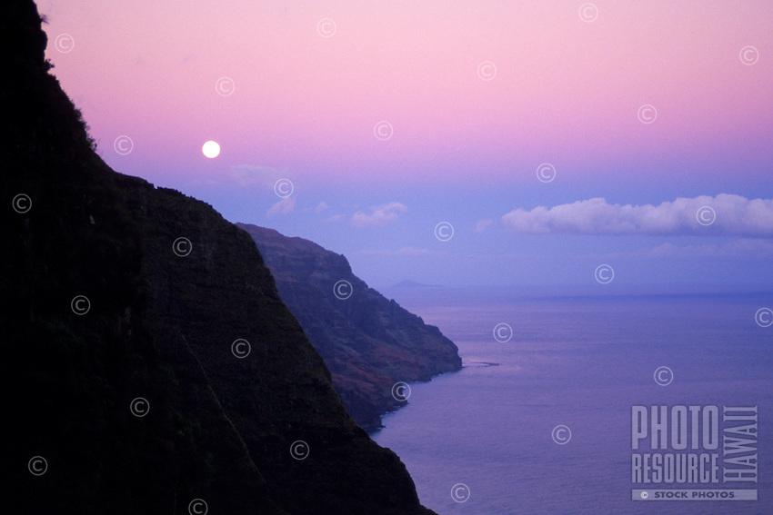 Beautiful moonrise along the Na Pali Coast; sunset over Kalalau Valley. Na Pali Coast State Park.