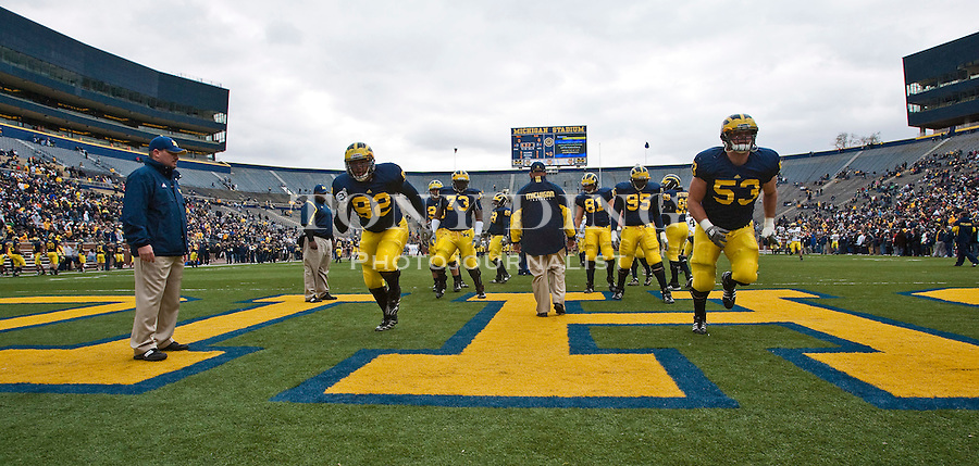 Michigan defensive tackle Greg Banks (92), defensive tackle Ryan Van Bergen (53), and teammates run through warm up drills before the Wolverines' spring football game at Michigan Stadium, Saturday, April 17, 2010, in Ann Arbor, Mich. (AP Photo/Tony Ding)