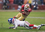 San Francisco 49ers running back Frank Gore (21) is tackled by New York Giants defensive back Kenny Phillips (21) during an NFC Championship NFL football game on January 22, 2012 in San Francisco, California. The Giants won 20-17 in overtime. (AP Photo/David Stluka)