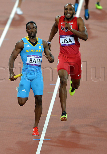 10.08.2012. London, England. Ramon Miller Blue of Bahamas Sprints into the finish ahead of the USA runner in the mens 4x400m Relay Final London 2012 Olympic Games The  team Won Gold Medal with 2 56 72