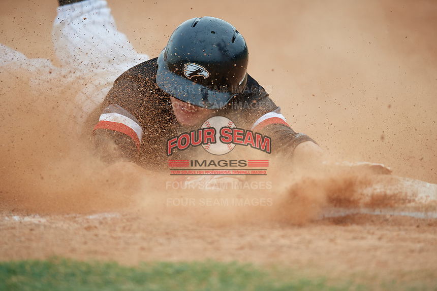 Edgewood Eagles Ryan Fields (9) slides head first into third base during a game against the South Vermont Mountaineers on March 18, 2019 at Lee County Player Development Complex in Fort Myers, Florida.  South Vermont defeated Edgewood 19-6.  (Mike Janes/Four Seam Images)