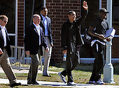 United States President Barack Obama waves as he walks with aide Reggie Love (R) and his Secret Service detail as he departs the physical fitness building after a morning of basketball at the Fort McNair facility, to return to the White House in Washington, DC, USA, USA 07 Sunday, March 2010.  Obama is to make a statement on the elections in Iraq later in the day.   .Credit: Mike Theiler / Pool via CNP
