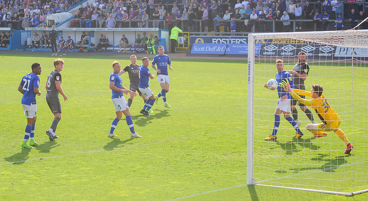 Carlisle United's Adam Collin makes a save to deny Lincoln City's Danny Rowe<br /> <br /> Photographer Chris Vaughan/CameraSport<br /> <br /> The EFL Sky Bet League Two - Carlisle United v Lincoln City - Friday 19th April 2019 - Brunton Park - Carlisle<br /> <br /> World Copyright © 2019 CameraSport. All rights reserved. 43 Linden Ave. Countesthorpe. Leicester. England. LE8 5PG - Tel: +44 (0) 116 277 4147 - admin@camerasport.com - www.camerasport.com