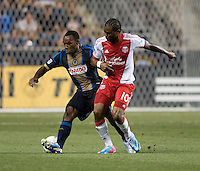 Amobi Okugo (14) of the Philadelphia Union fights for the ball with Frederic Piquionne (10) of the Portland Timbers during a Major League Soccer game at PPL Park in Chester, PA.  Philadelphia Union tied the Portland Timbers, 0-0.