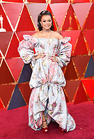 Andra Day arrives at the Oscars on Sunday, March 4, 2018, at the Dolby Theatre in Los Angeles. (Photo by Richard Shotwell/Invision/AP)