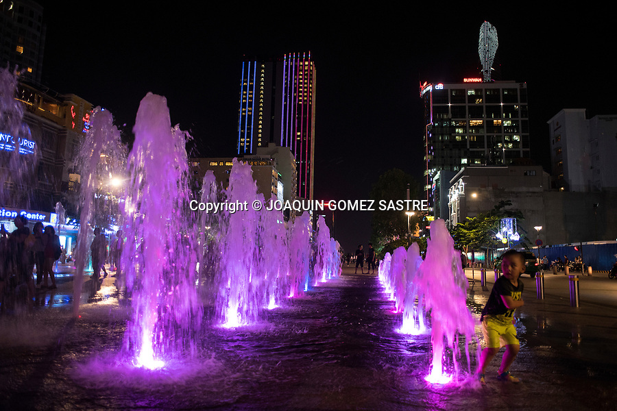 A child plays with water at the colored fountain in Nguyen Hue area in Ho Chi Minh City (Vietnam)<br /> HO CHI MINH-VIETNAM