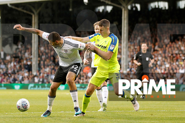 Aleksander Mitrovic of Fulham fends off Craig Forsyth of Derby County during the Sky Bet Championship play off semi final 2nd leg match between Fulham and Derby County at Craven Cottage, London, England on 15 May 2018. Photo by Carlton Myrie / PRiME Media Images.