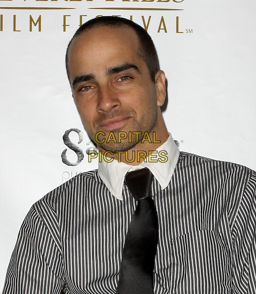 JESSE BILAUER .10th Annual International Beverly Hills Film Festival - Opening Night held At The Clarity Theatre,  Beverly Hills, California, USA, .14th April 2010..portrait headshot grey gray pinstripe white shirt tie black .CAP/ADM/KB.©Kevan Brooks/AdMedia/Capital Pictures.